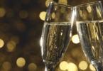 Flutes of champagne in holiday setting,Closeup. via Shutterstock