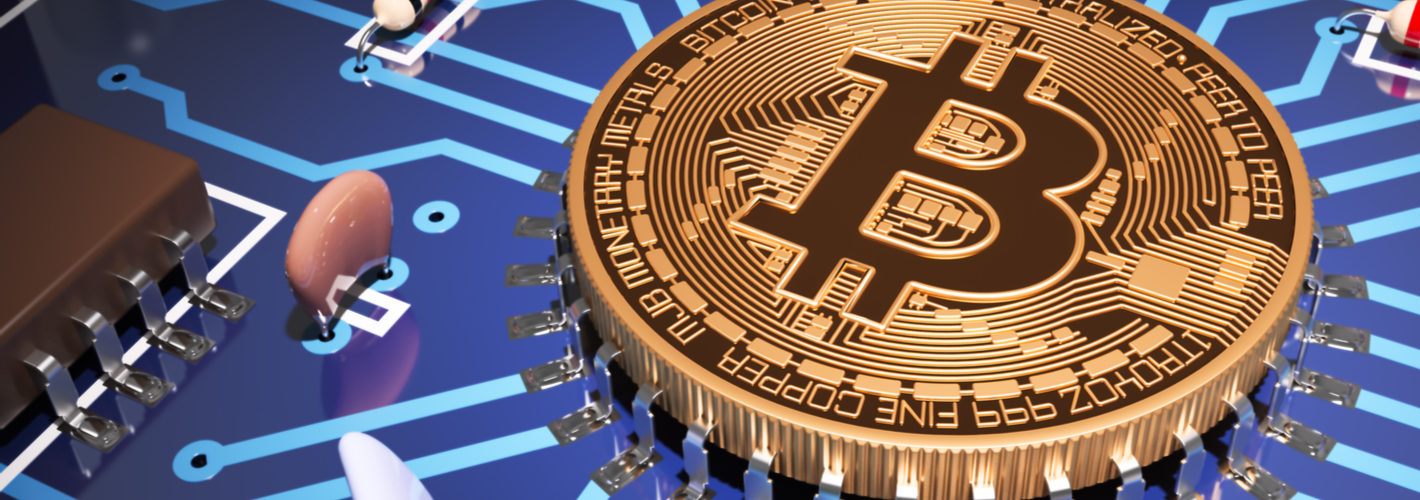 Concept Of Bitcoin Like A Computer Processor On Motherboard. via Shutterstock
